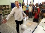 Greek Finance Minister Varoufakis votes in national referendum at a polling station in Athens
